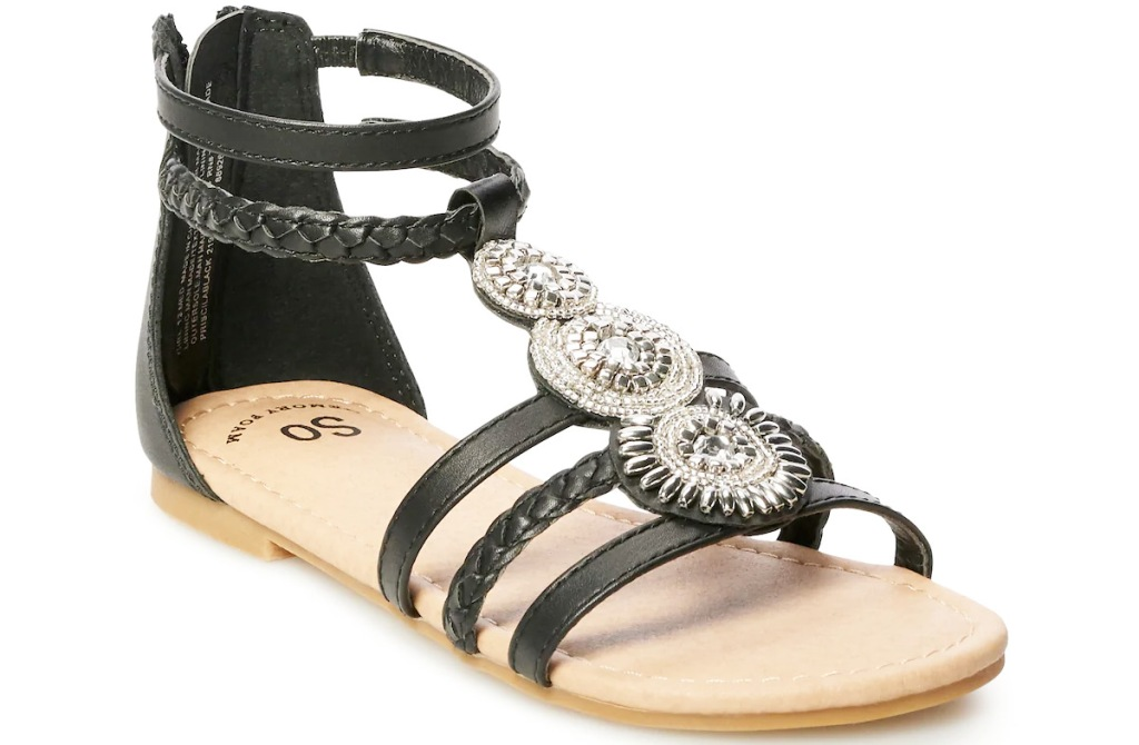 girls black gladiator sandal with three silver medallions on top