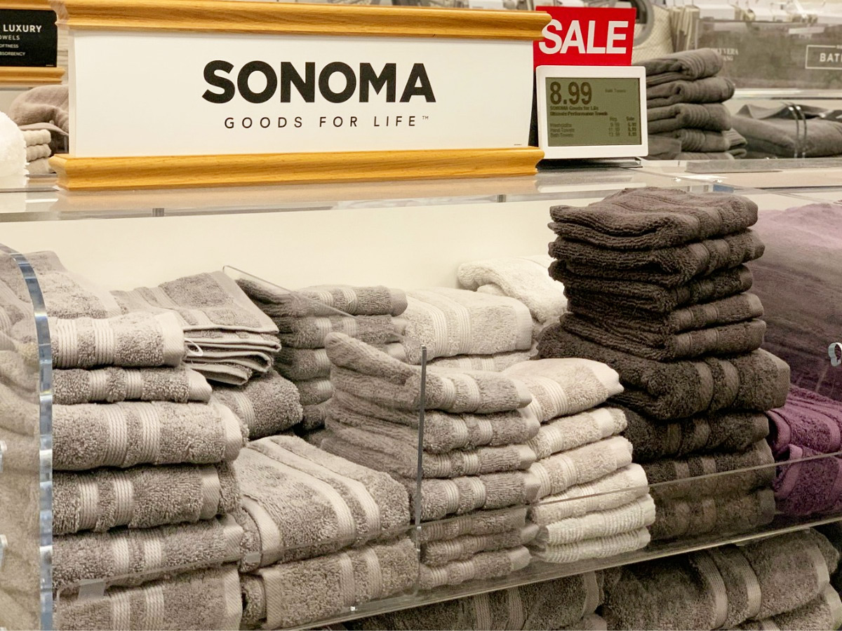 store display of sonoma bath towels in grey and brown colors