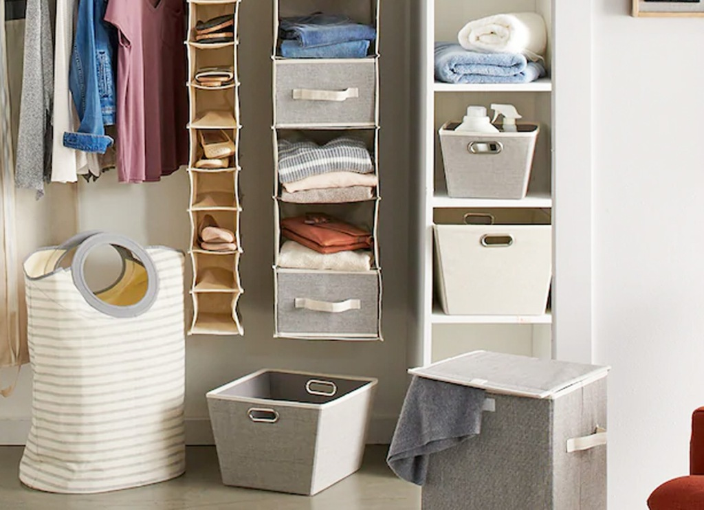 various sizes of fabric storage bins inside hanging storage organizers inside a closet