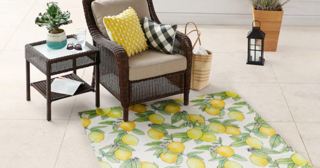 lemon area rug under armchair and side table