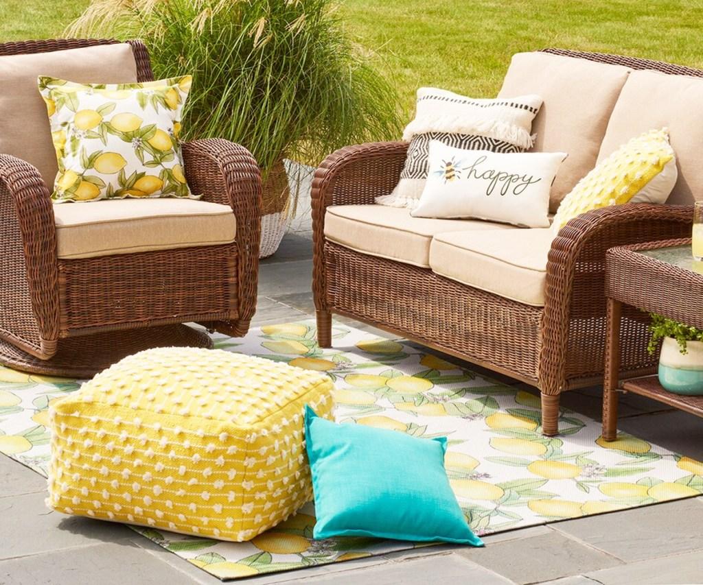 wicker outdoor patio set on a lemon print outdoor rug