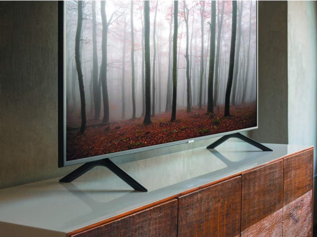 large tv on wood tv stand