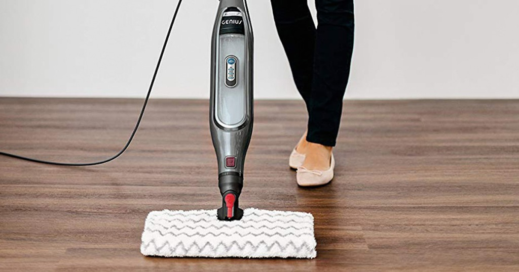 woman pushing shark genius steam mop on hardwood floors
