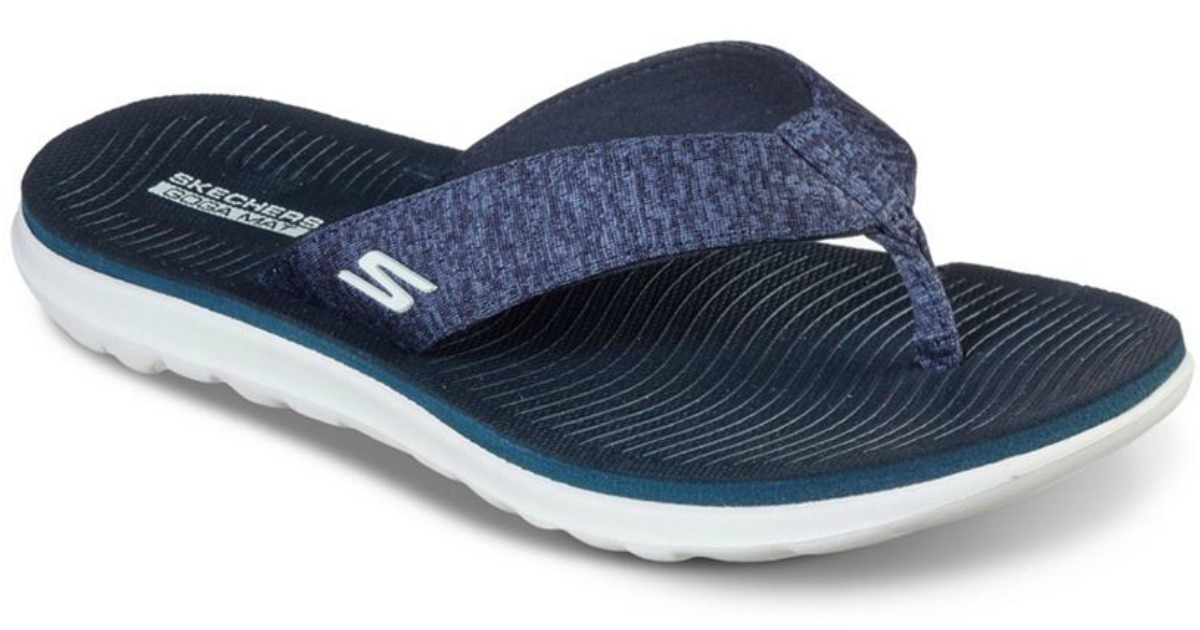 pair of navy blue and white cushioned flip flops