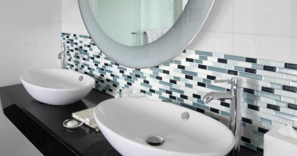 bathroom sink with tile backsplash