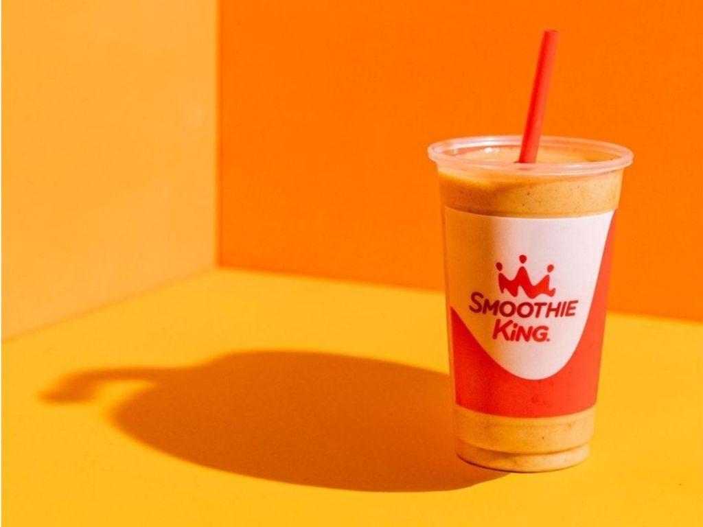 pumpkin smoothie with a pumpkin shaped shaddow