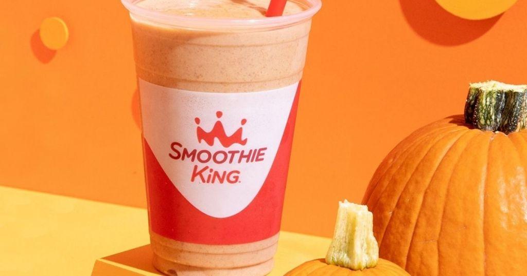 smoothie king pumpkin flavored next to a real pumpkin