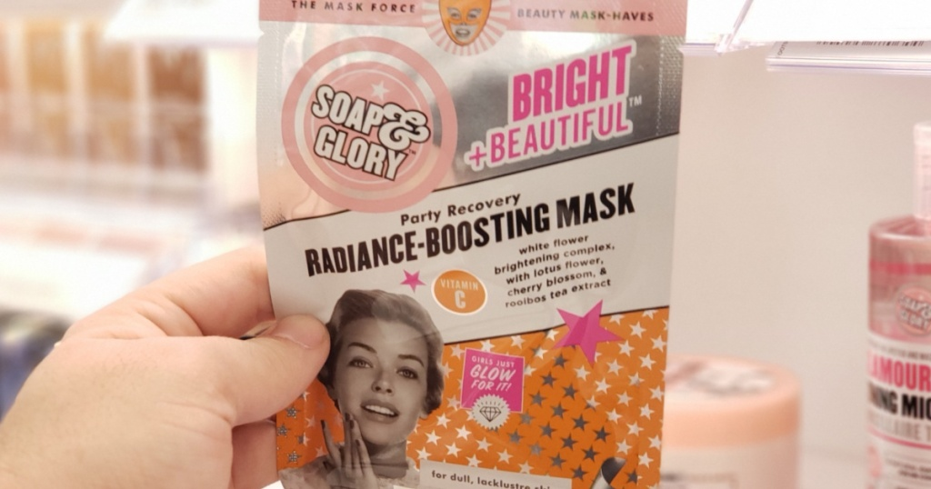 hand holding Soap & Glory Bright and Radiant Face Masks in-store