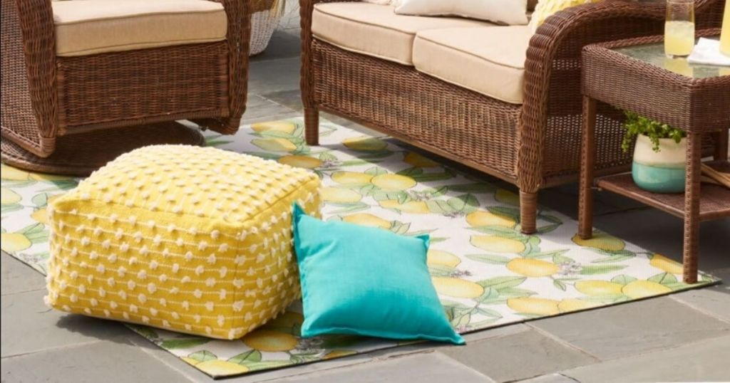 area rug with patio furniture on deck