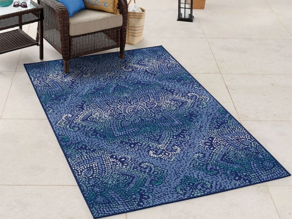 area rug with chair and end table