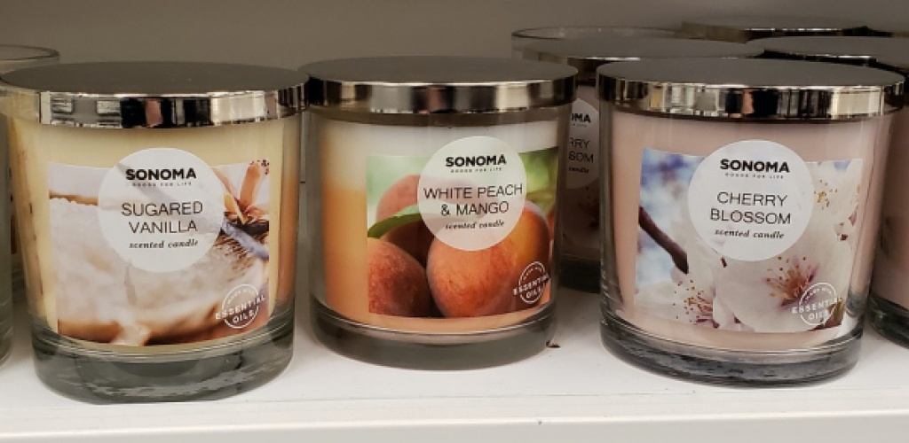 three different scented jar candles on store shelf