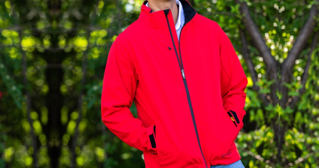 Man wearing a bright red jacket with his hand in his pockets