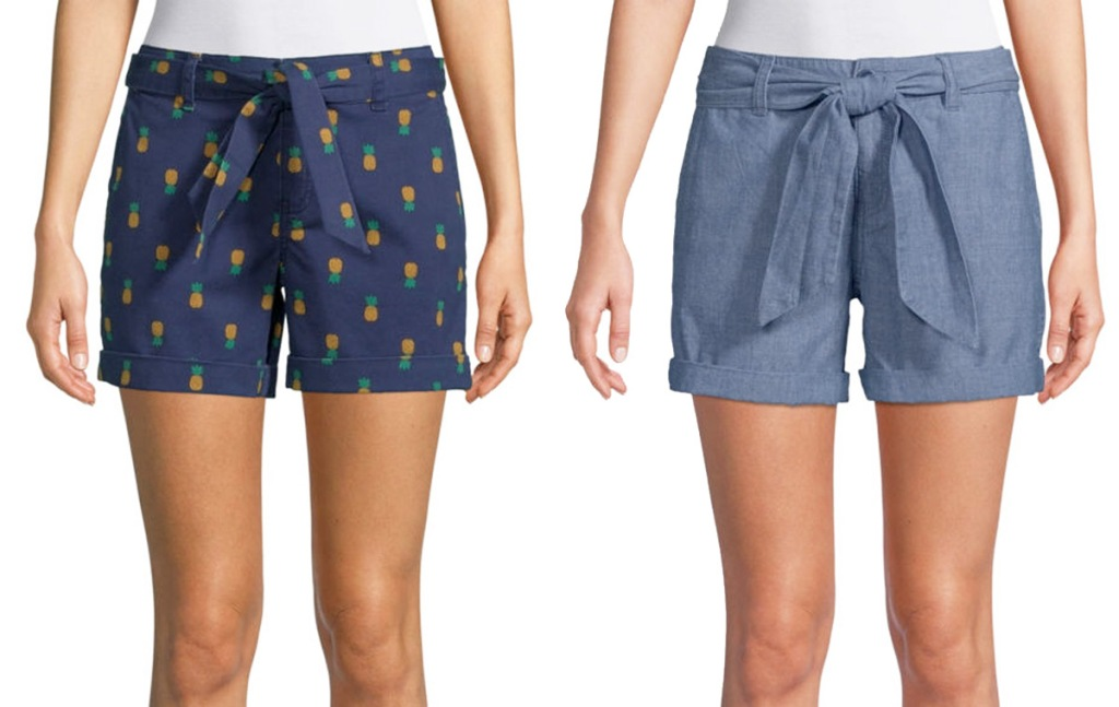 two women modeling shorts with tie waists in blue with pineapple print and medium denim colors