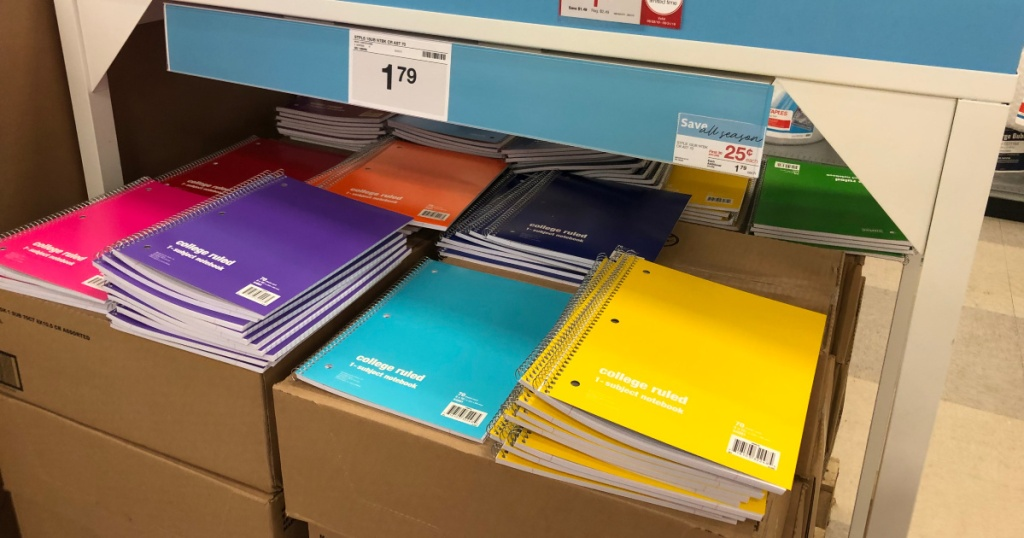 box of multiple colored staples spiral notebooks