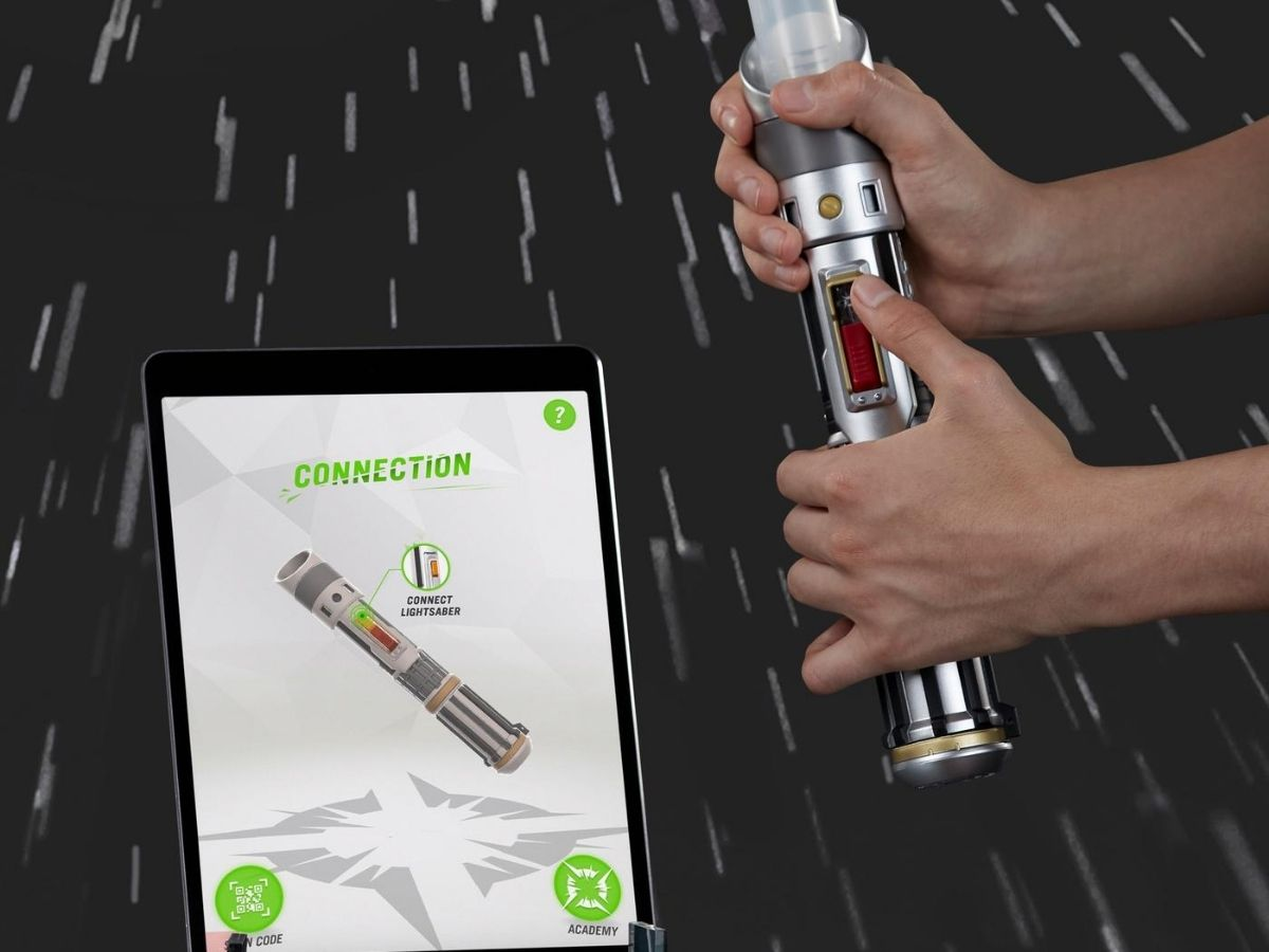 lightsaber in child's hands and ipad
