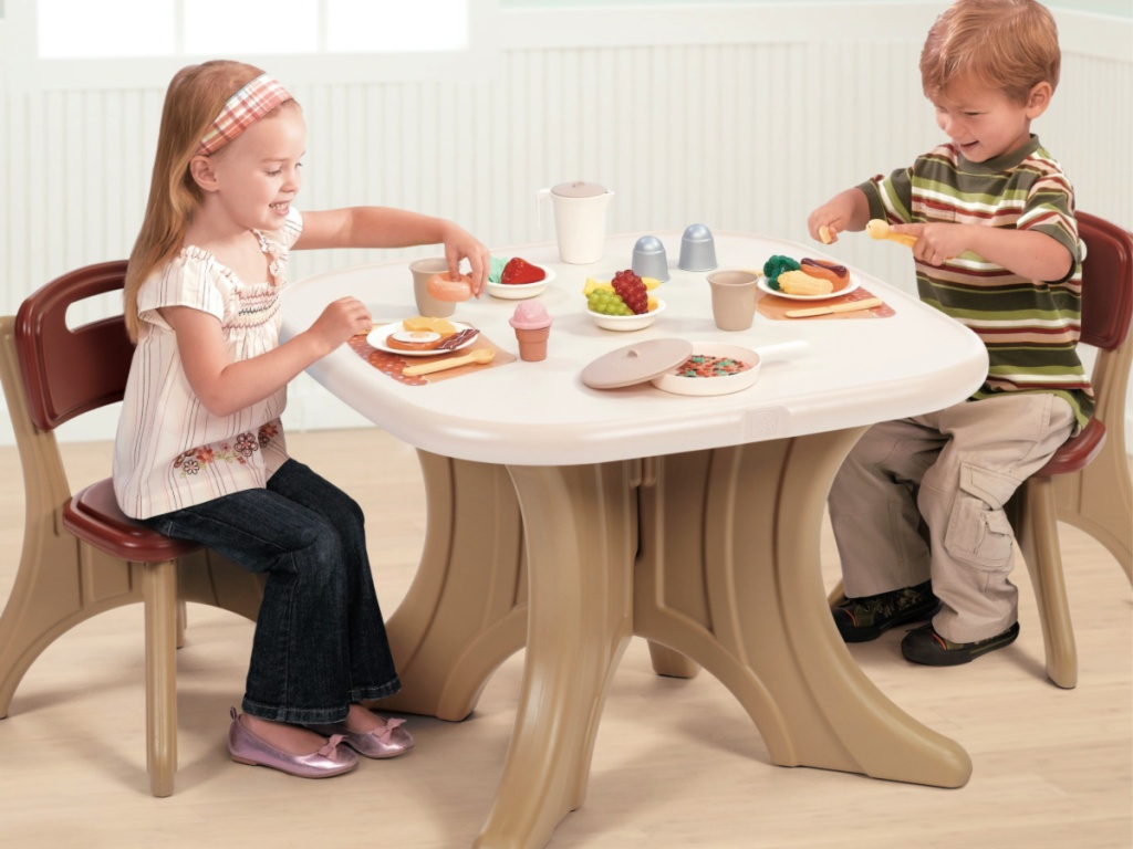 kids in playroom sitting at a Step2 New Traditions Kids Table and 2 Chairs Set