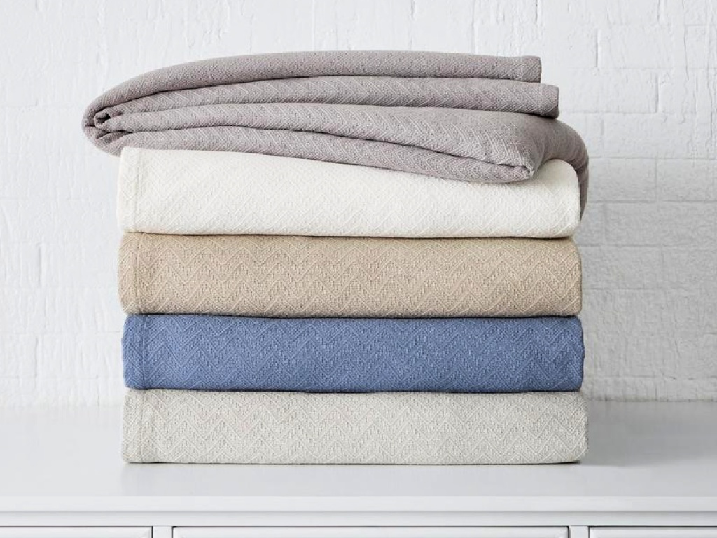 StyleWell Cotton Blankets folded up on dresser