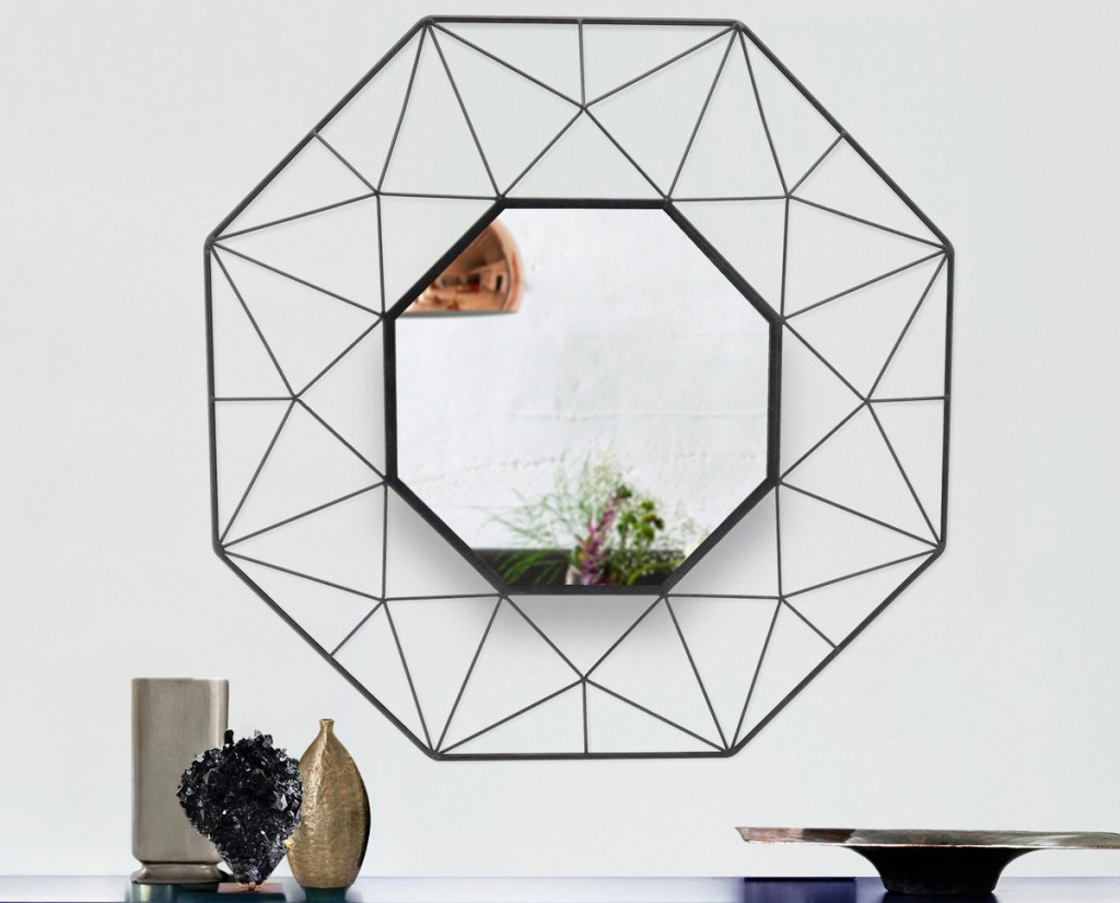 black framed octagon shaped mirror on white wall