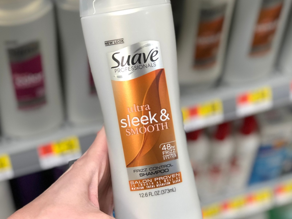 hand holding suave shampoo in-store at walmart