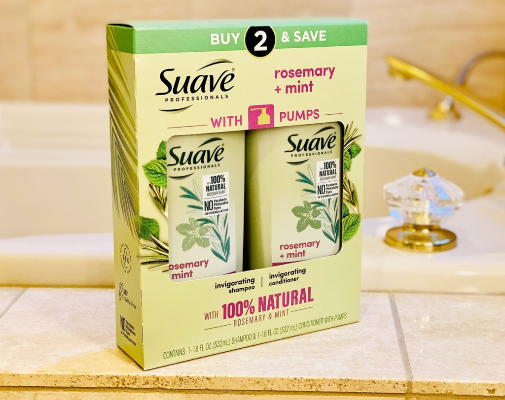 green bonus pack of suave professionals shampoo and conditioner sitting on edge of tub