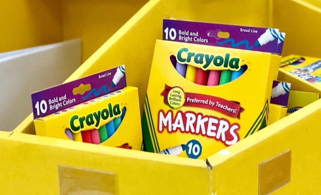yellow store display with yellow boxes of crayola bold markers