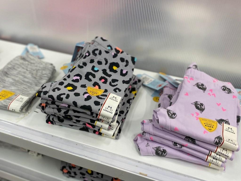 Girls Leggings folded on a shelf in-store at Target