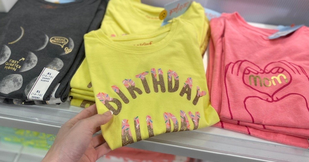 hand holding birthday all day yellow graphic tee in target