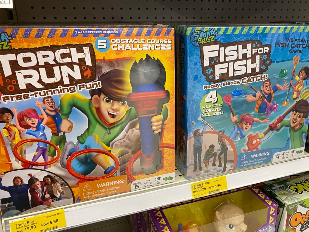 Torch Run and Fish Strike Board Games sitting on target store shelf