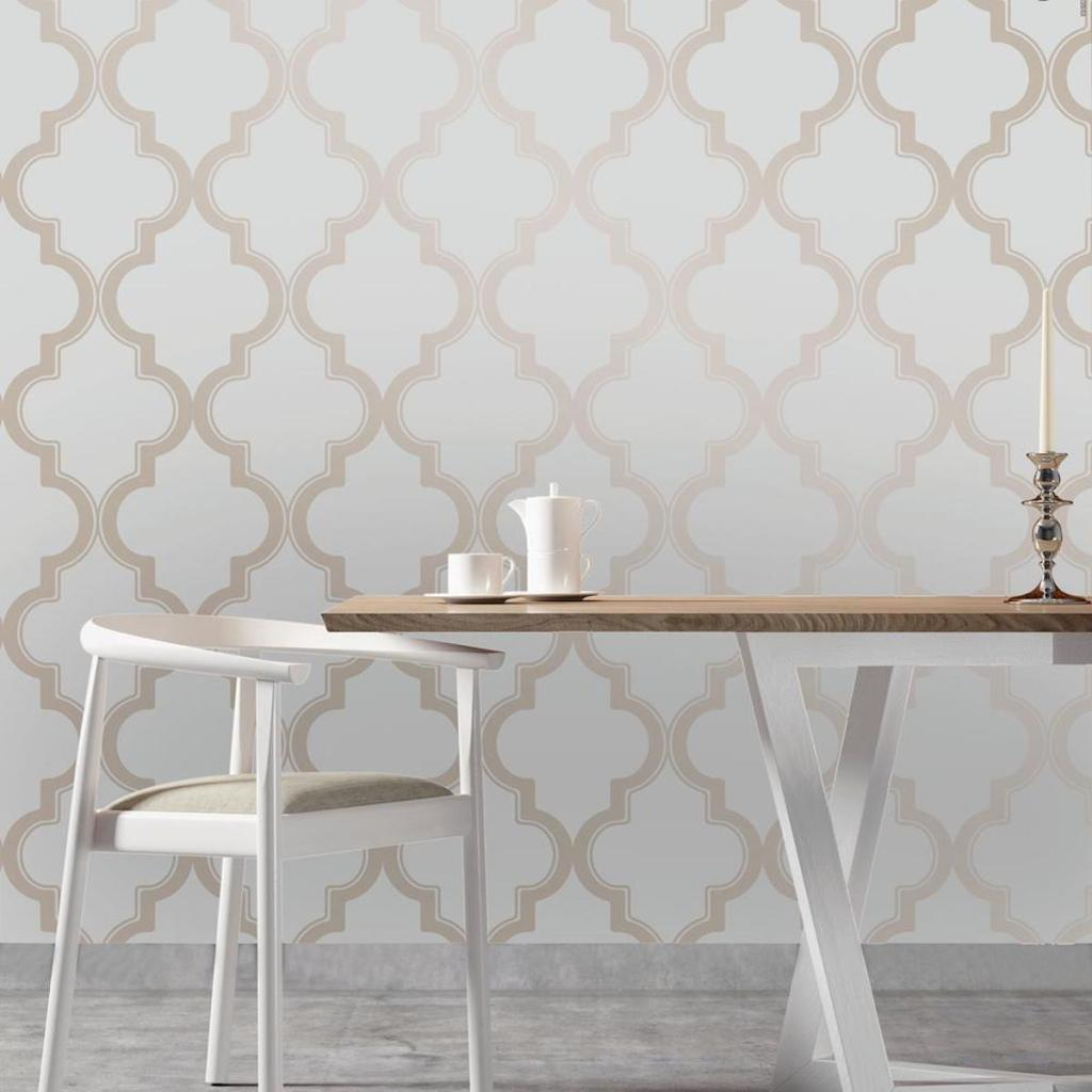 Tempaper Marrakesh WallPaper on wall with small kitchen table in front of the wall with a white chair