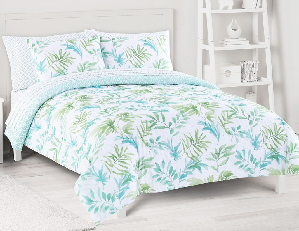 white comforter set with blue and green palm print and matching pillow shams
