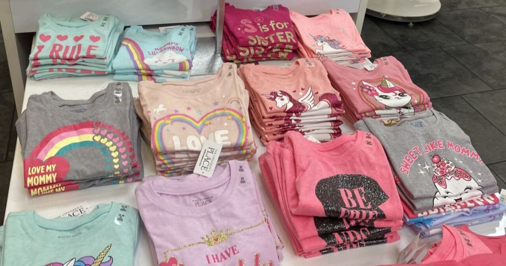table with girls shirts