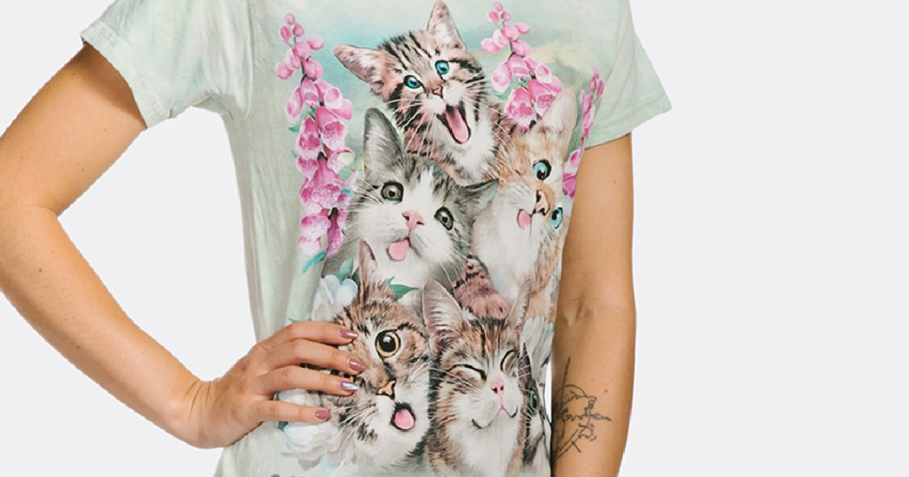 woman standing with a hand on her hip wearing a t-shirt with kittens