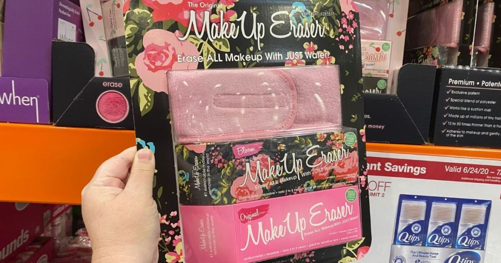 hand holding up The original makeup eraser in packaging at store