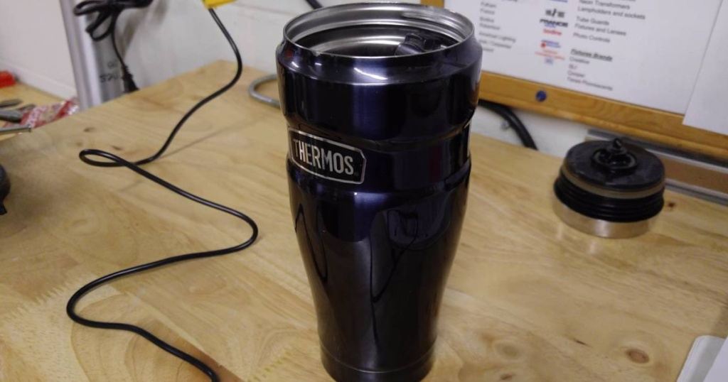 navy colored thermos king tumbler with the lid off on table