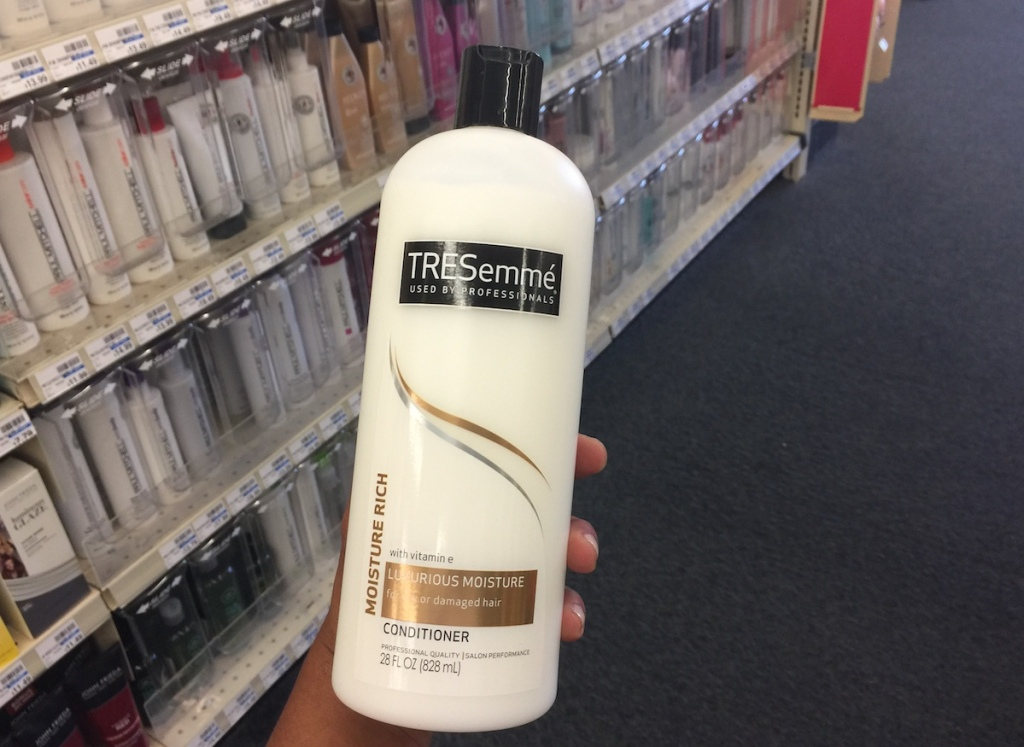 hand holding bottle of Tresemme Conditioner