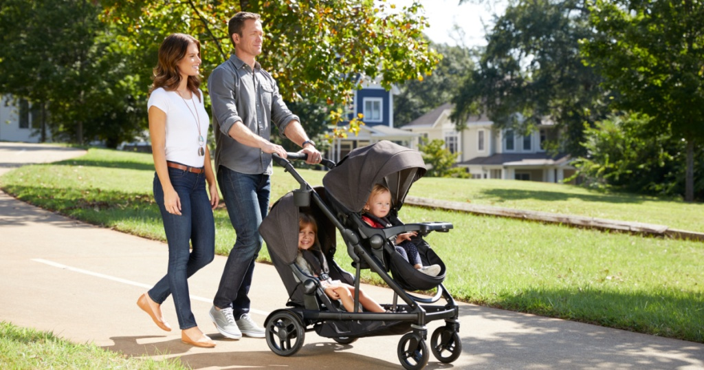 couple walking with kids in stroller