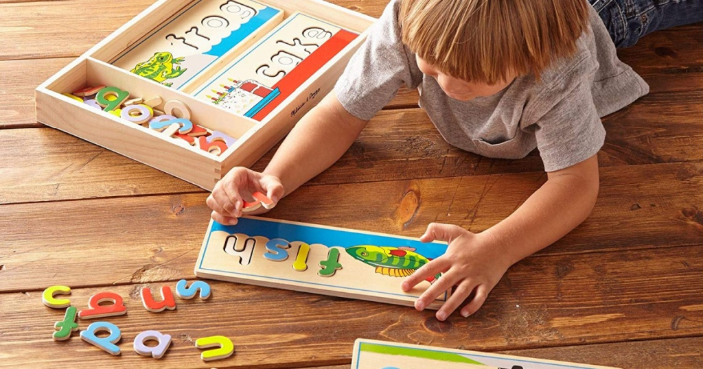 melissa and doug see and spell multi little boy playing