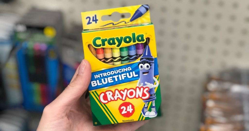 hand holding box of 24 count crayola crayons in store