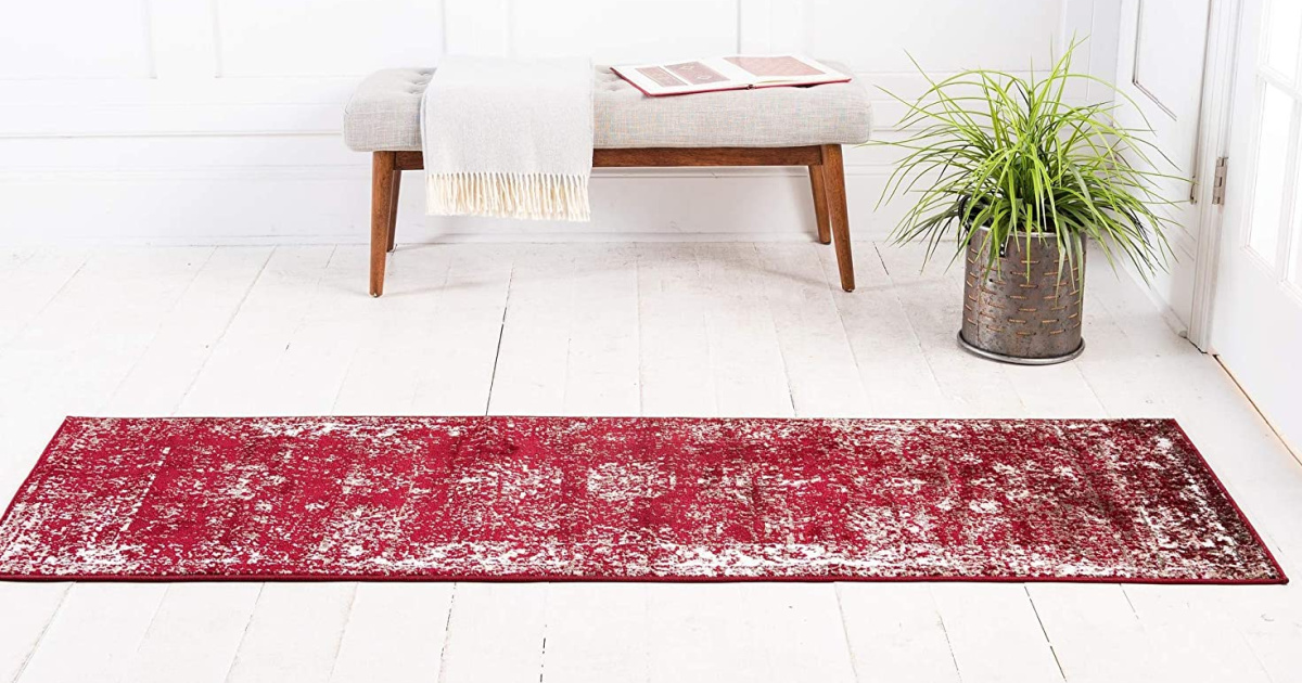 unique loom sofia runner burgundy with bench and plant