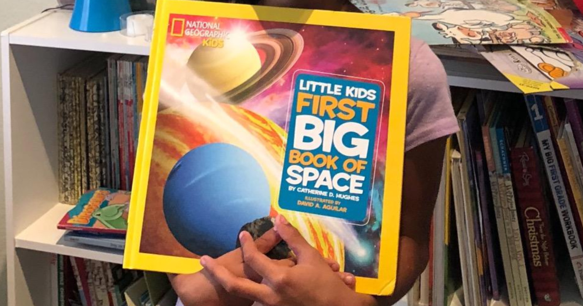 national geographic kids space book little girl holding book