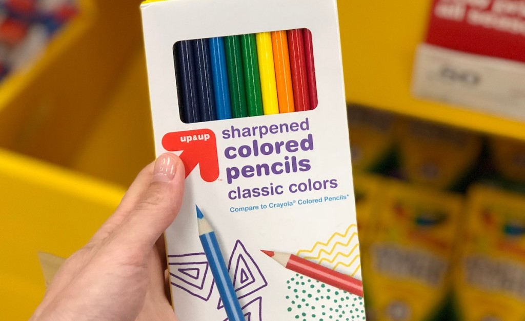 hand holding package of colored pencils