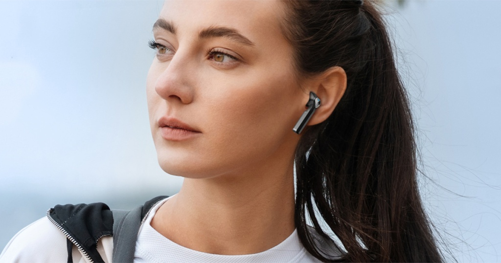 woman with black wireless bluetooth earbud in her ear