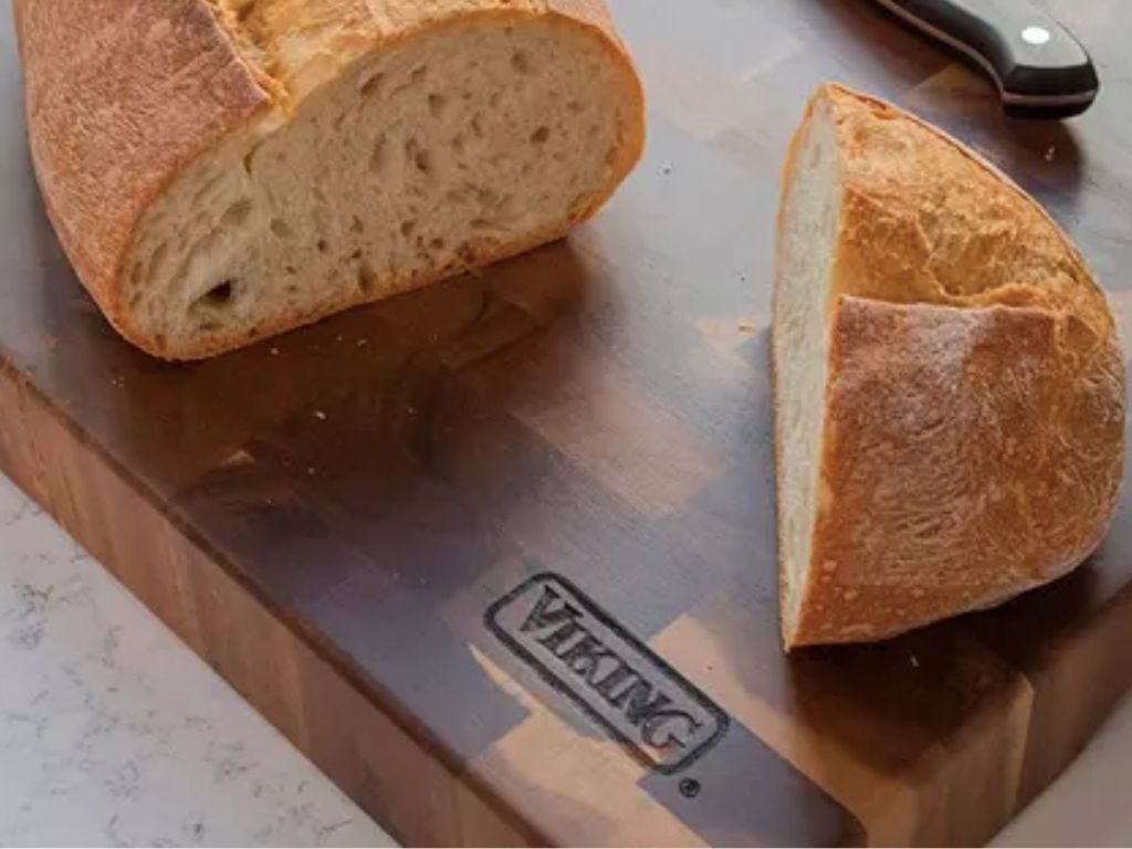 thick cutting board with load of bread on top