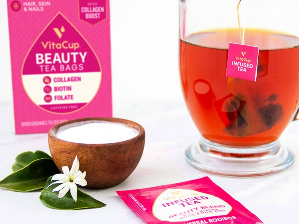 VitaCup Beauty Blend Infused Tea 14-Count Box with cup of tea