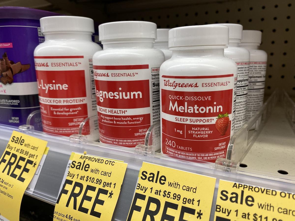 row of Walgreens vitamins on a store shelf