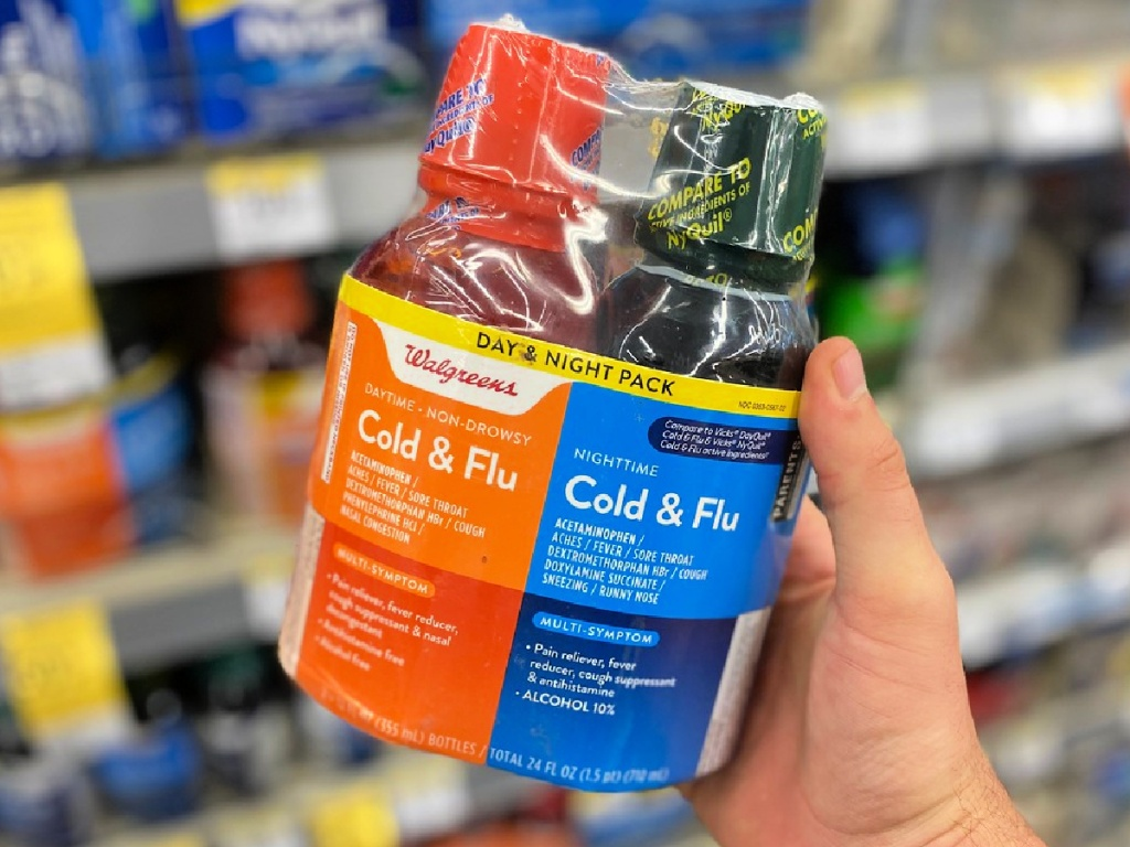 person holding Walgreens Severe Cold & Flu Day & Night Pack
