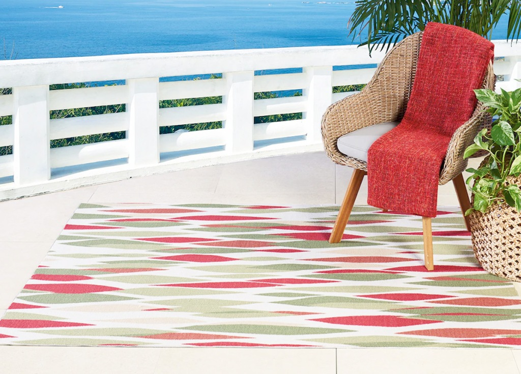 multi colored outdoor area rug on patio overlooking beach