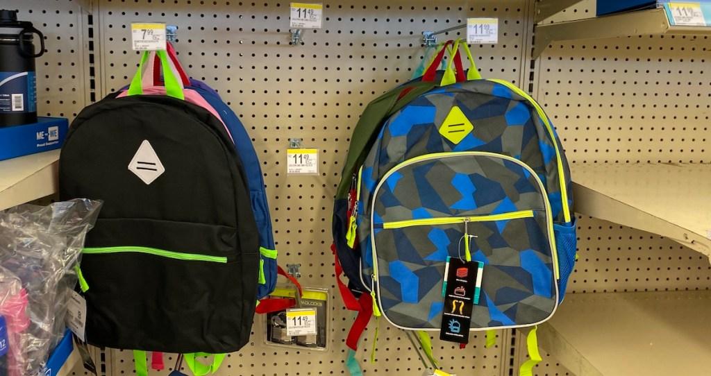 backpacks hanging on hooks at Walgreens
