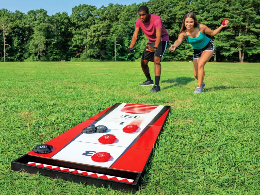 man and woman playing Wicked Big Sports Shuffle Toss