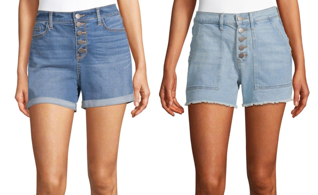 two women modeling denim shorts with five button closure
